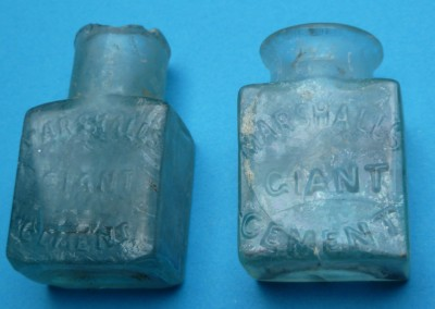 Tiny Cement Bottles