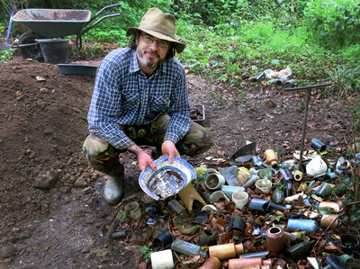 Tom searches through the finds